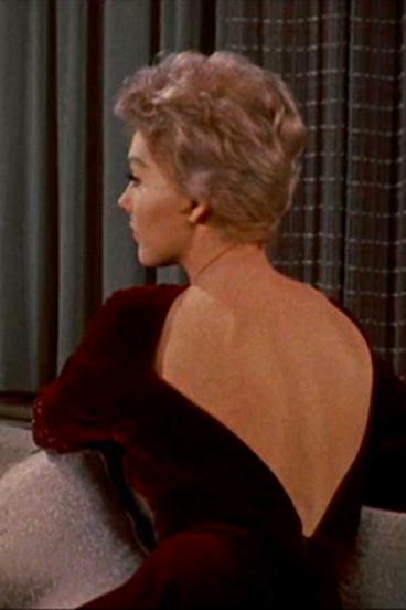 Kim Novak in a red velvet dress