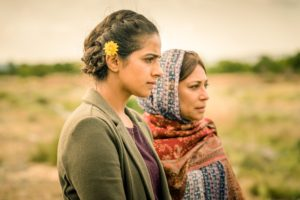 Demons of Punjab promo image - Yas and her great-grandmother standing in a meadow.